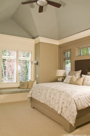 Traditional Master Bedroom with Ceiling fan, High ceiling, Window seat, Crown molding, Carpet, flush light