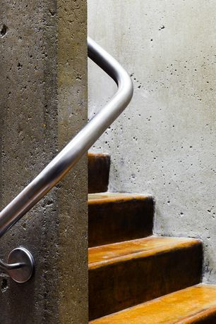 Contemporary Staircase with Concrete floors