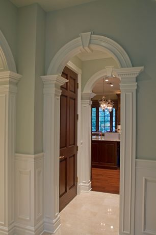 Traditional Hallway with Wainscotting, Concrete tile , six panel door, Paint, Hardwood floors, Paint 2, Arched doorway