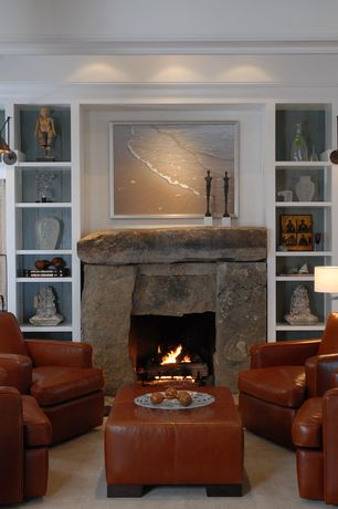Rustic Living Room with Crown molding, High ceiling, Turner leather armchair, Turner leather ottoman, Built-in bookshelf