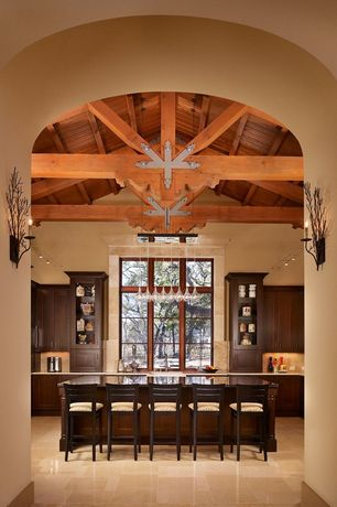 Rustic Kitchen with travertine tile floors, Wall sconce, Cathedral ceiling, Casement, Flat panel cabinets, stone tile floors