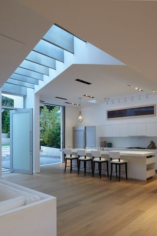 Contemporary Kitchen with Breakfast bar, Simple marble counters, Skylight, full backsplash, Pendant light, French doors
