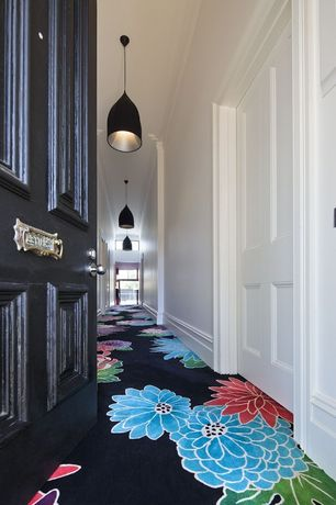 Contemporary Hallway with specialty door, Crown molding, Carpet, Pendant light