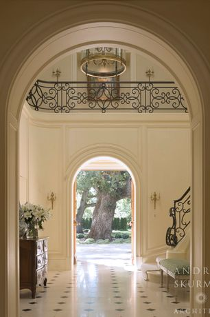 Traditional Entryway with simple marble tile floors, Balcony, stone tile floors, High ceiling