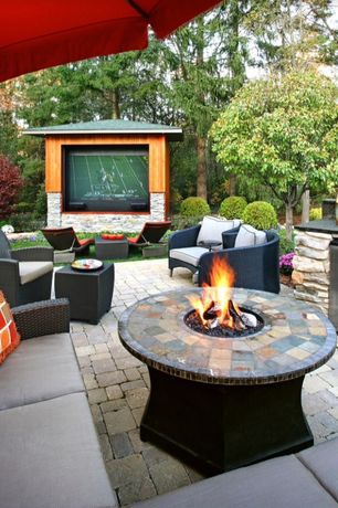 Contemporary Patio with Outdoor kitchen, exterior stone floors, Fire pit