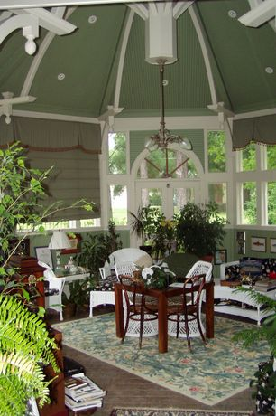 Tropical Living Room with sandstone tile floors, picture window, Exposed beam, Transom window, High ceiling, can lights