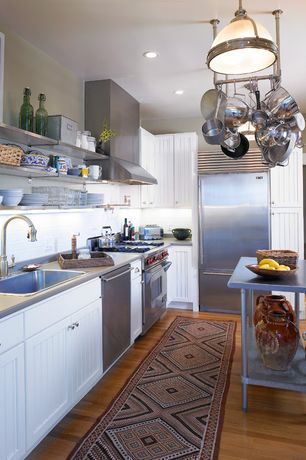 Contemporary Kitchen with Breakfast bar, can lights, Flat panel cabinets, Slate, Kitchen island, Slate counters, Flush