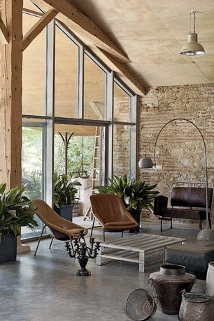 Contemporary Living Room with High ceiling, Pendant light, French doors, Exposed beam, Concrete floors, Transom window