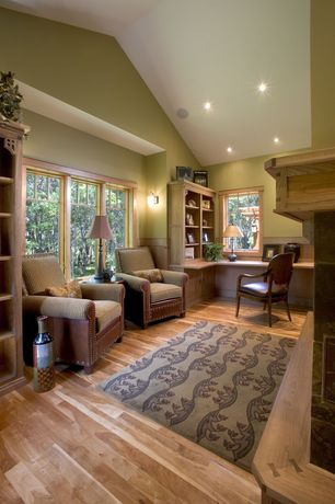 Country Home Office with Wainscotting, Built-in bookshelf, Hardwood floors, Wall sconce, High ceiling