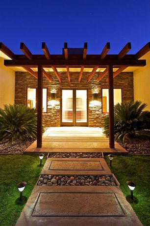 Contemporary Front Door with Pathway, exterior stone floors, Spider leg beam, Raised beds, French doors, Exposed beam