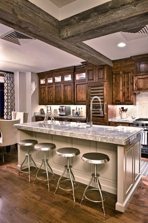 Contemporary Kitchen with Wine refrigerator, Breakfast bar, Raised panel, Penny Tile, Complex granite counters, Glass panel