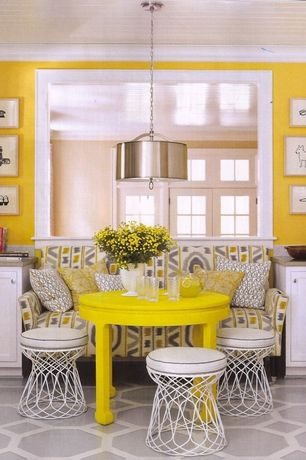Contemporary Dining Room with Crown molding, Pendant light, Standard height, Transom window, Built-in bookshelf, Carpet