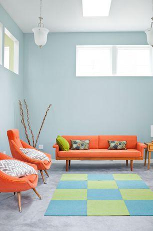 Contemporary Living Room with Pendant light, flush light, Concrete floors, High ceiling