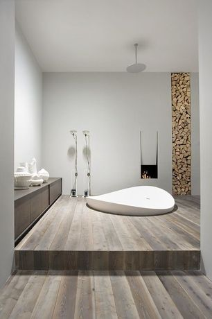 Contemporary Master Bathroom with Soapstone counters, Evolution Built-in Bathtub / Triangular / Acrylic, Rain shower
