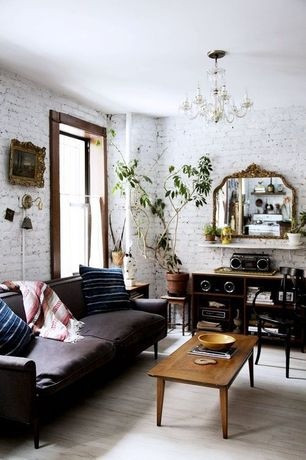 Eclectic Living Room with Chandelier, Hardwood floors, Asia Timber Cross Back Armchair, Wall sconce, interior brick