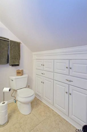 Traditional Powder Room with Raised panel, Arizona Tile - Nu Travertine Cream Porcelain Tile, Flush, Powder room