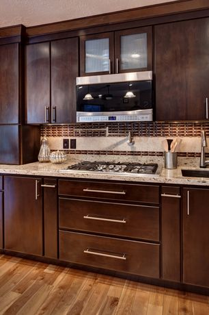 Modern Kitchen with Stone Tile, Undermount sink, Flush, Simple granite counters, Glass panel, Pendant light, electric cooktop