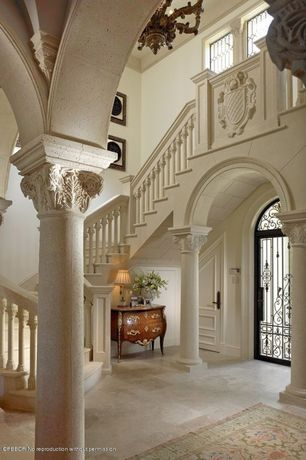 Traditional Entryway with travertine floors, Columns, Cathedral ceiling, French doors, Arched window, Crown molding, Loft