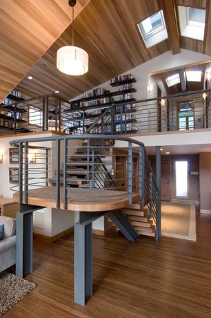 Contemporary Staircase with curved staircase, Hardwood floors, Paint 1, Columns, Pendant light, Skylight, Loft