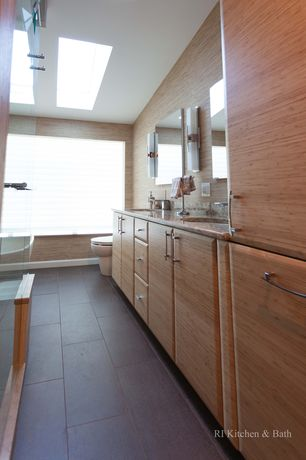Contemporary Master Bathroom with Wall sconce, Complex granite counters, Skylight, frameless showerdoor, Complex Granite