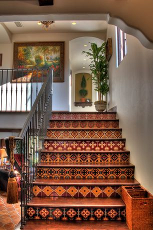 Mediterranean Staircase with Hardwood floors, Chandelier, Natural wood finished stair treads, Painted ceramic tile, Artwork