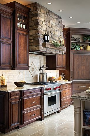 Traditional Kitchen with Dark stained cabinetry, Raised center panel full overlay cabinets, L-shaped, Stone Tile, Slate Tile