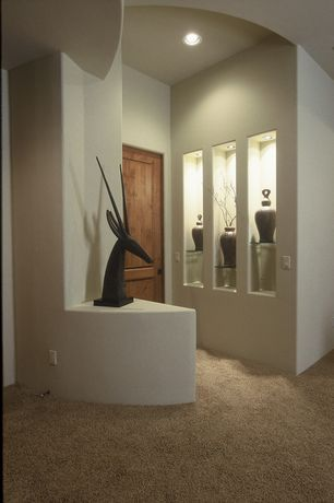 Contemporary Hallway with Carpet, Clewell Pottery Vase, specialty door, Gareth Sculpture