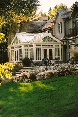 Traditional Exterior of Home with Sun room, Pathway, French doors, Transom window, Raised beds