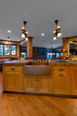 Craftsman Kitchen with Flat panel cabinets, Farmhouse sink, Breakfast bar, Calico hickory butcher block countertop