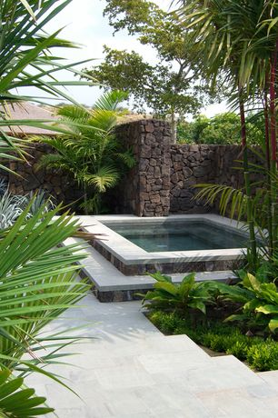 Tropical Hot Tub with exterior tile floors, Fence, Pool with hot tub