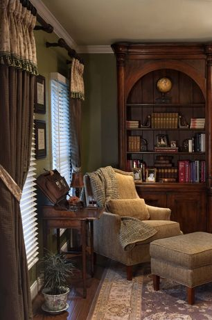 Traditional Living Room with Crown molding, Hardwood floors, Arched bookshelf, Area rug, Laminate floors, Built-in bookshelf