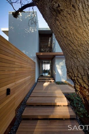 Modern Entryway with Wood entry steps, Minimalist landscaping, Sold Wood Panel
