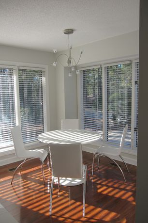 Contemporary Dining Room with Hardwood floors, High ceiling, Eat in kitchen, Chandelier