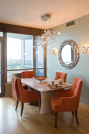 Eclectic Dining Room with Hardwood floors, Standard height, French doors, Transom window, Chandelier, picture window