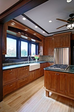 Craftsman Kitchen with Pental black soapstone, Inset cabinets, Flat panel cabinets, Complex granite counters, Hardwood floors