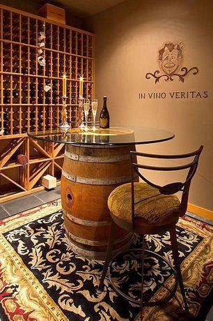 Craftsman Wine Cellar with stone tile floors, Standard height, Built-in bookshelf, travertine tile floors