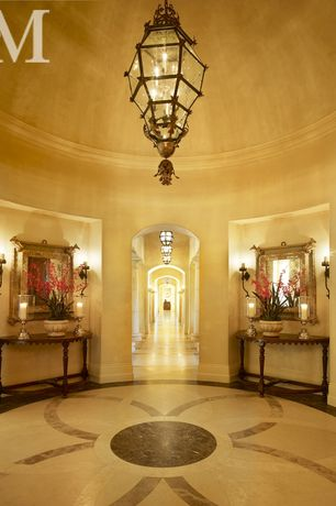 Traditional Entryway with Wall sconce, High ceiling, simple marble floors, Chandelier, Crown molding