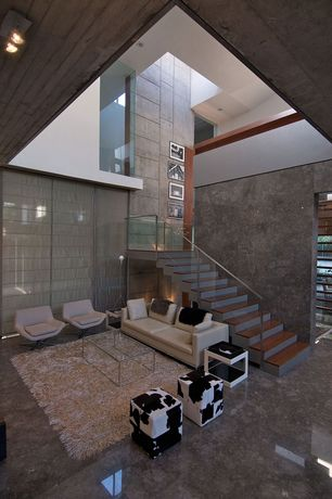 Modern Living Room with can lights, quartz floors, High ceiling, picture window, Loft
