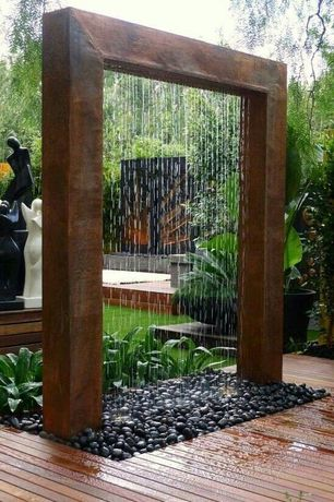 Tropical Landscape/Yard with Water feature, Arbor, Custom Glass Walls, Palm Sized Black Polished Rocks