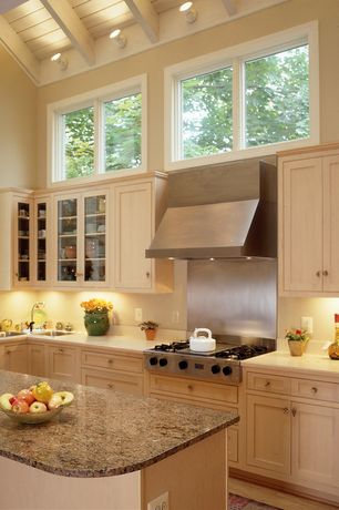 Contemporary Kitchen with L-shaped, Flat panel cabinets, High ceiling, Limestone counters, Exposed beam, Wall sconce