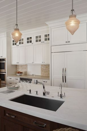 Cottage Kitchen with Quartz countertop, Glass panel, One-wall, Pendant light, Caesarstone - frosty carrina, Kitchen island
