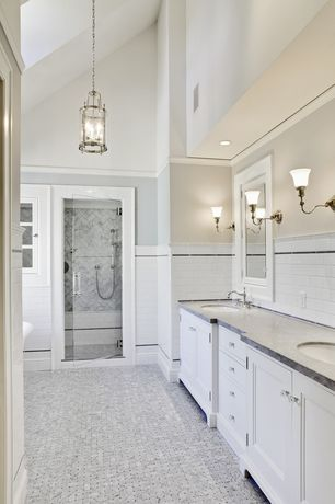 Traditional Master Bathroom with Wall sconce, Seneca 4 light single tier candle style chandelier, Subway tile wainscoting