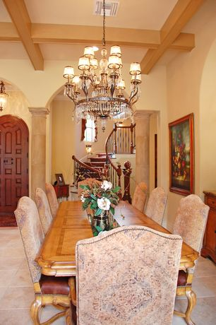 Mediterranean Dining Room with Exposed beam, Standard height, sandstone tile floors, stone tile floors, Columns, Chandelier