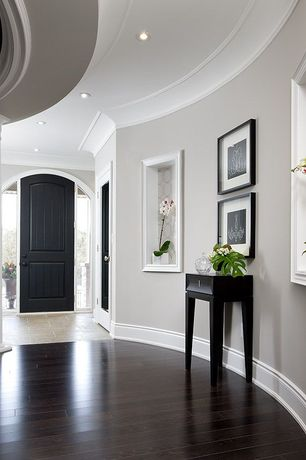Traditional Entryway with can lights, Hardwood floors, Standard height, sandstone tile floors, Columns, Crown molding