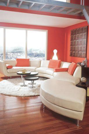 Modern Living Room with Safavieh shag area rug, Nesting table, Loft, Hardwood floors, Exposed beam