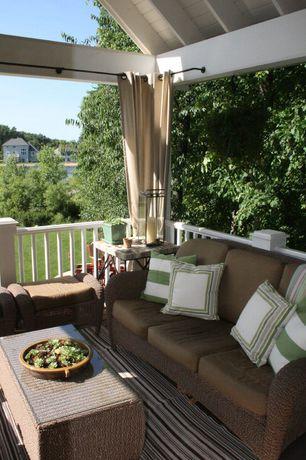 Cottage Porch with Sonoma outdoors cambria wicker ottoman, Threshold rolston wicker patio- 3 person sofa, Wrap around porch