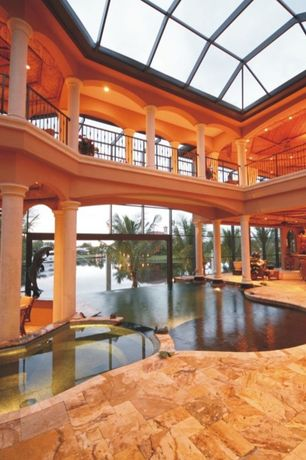 Mediterranean Swimming Pool with Skylight, exterior stone floors, Pool with hot tub, Infinity pool, Indoor pool