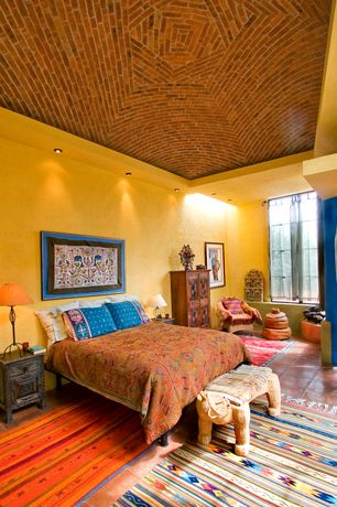 Eclectic Master Bedroom with can lights, Casement, High ceiling, terracotta tile floors, interior brick