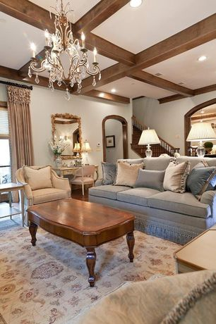 Traditional Living Room with Box ceiling, Art desk, French doors, Standard height, Wall sconce, can lights, Hardwood floors