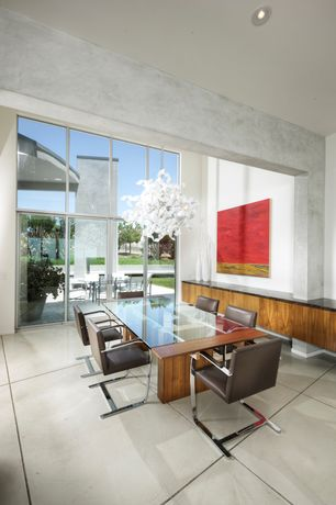 Modern Dining Room with Chandelier, High ceiling, Concrete floors